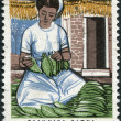 GREECE - CIRCA 1966: Postage stamps printed in Greece, dedicated to Greek tobacco industry, and 4th International Scientific Tobacco Congress, Athens, shows Woman sorting tobacco leaves, circa 1966 — Stock Photo #11975391