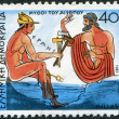 Stock Photo: GREECE - CIRC1987: Postage stamps printed in Greece, shows Aesops fables, Woodcutter and Hermes, circ1987