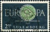 LUXEMBOURG - CIRCA 1960: A stamp printed in Luxembourg, shows the word EUROPE, the letter O as a bicycle wheel with 19 spokes, circa 1960 — Stock Photo