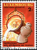 LUXEMBOURG - CIRCA 1980: A stamp printed in Luxembourg, is dedicated to 9th World Congress on Prevention of Occupational Accidents & Diseases, Amsterdam, shows a Worker Pouring Molten Iron, circa — Stock Photo
