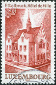 LUXEMBOURG - CIRCA 1980: A stamp printed in Luxembourg, shows Ettelbruck Town Hall, circa 1980 — Stock Photo