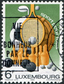 """LUXEMBOURG - CIRCA 1980: A stamp printed in Luxembourg, represented sports equipment and the slogan """"Sport for All"""", circa 1980 — Stock Photo"""