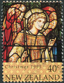 NEW ZEALAND - CIRCA 1995: A stamp printed in New Zealand, is dedicated to Christmas, Stained glass windows, depicts Archangel Gabriel, circa 1995 — Stock Photo