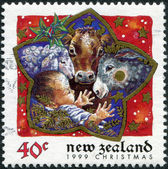NEW ZEALAND - CIRCA 1999: A stamp printed in New Zealand, dedicated to the Christmas shows Baby in manger, circa 1999 — Stock Photo