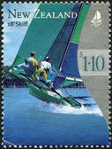 NEW ZEALAND - CIRCA 1999: Postage stamps printed in New Zealand, shows yacht, 18-foot skiff, circa 1999 — Stockfoto