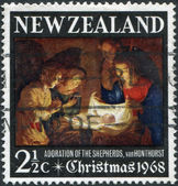 NEW ZEALAND - CIRCA 1968: A stamp printed in New Zealand, dedicated to the Christmas, shows Adoration of the Holy Child by Gerard van Honthorst, circa 1968 — Stock Photo