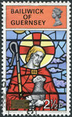 GUERNSEY - CIRCA 1973: A stamp printed in the Bailiwick of Guernsey, shows the Good Shepherd, St. Michel du Valle, circa 1973 — Stock Photo