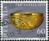 SWITZERLAND - CIRCA 1973: A stamp printed in Switzerland, represented Gold bowl, 6th century B.C., circa 1973 — Stock Photo