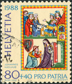 SWITZERLAND - CIRCA 1988: A stamp printed in Switzerland, dedicated to the 700 Years of art and culture - Swiss Minnesang, depicts Portrait of Master Johannes Hadlaub as a pilgrim, circa 1988 — Stock Photo