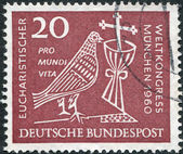GERMANY - CIRCA 1960: A stamp printed in Germany, dedicated to 37th Eucharistic World Congress, Munich, depicted Dove, Chalice and Crucifix, circa 1960 — Stock Photo