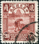 CHINA - CIRCA 1914: A stamp printed in China (Taiwan), is shown reaping rice (postage stamp printed in Beijing), circa 1914 — Stock Photo