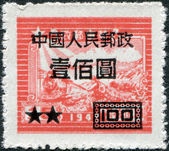 CHINA - CIRCA 1949: A stamp printed in China, dedicated to the 7th anniversary of the postal administration, is depicted Train and Postal Runner (overprint, 1950), circa 1949 — Stock Photo
