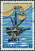 GREECE - CIRCA 1981: A stamp printed in Greece, dedicated to Inauguration of oil production at Thassos Island, shows the Oil Rig and Map of Thassos Island, circa 1981 — Stock Photo