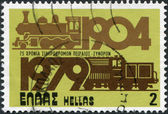 GREECE - CIRCA 1979: A stamp printed in Greece, is dedicated to the 75th anniversary of the railway Piraeus - Athens, shows a steam locomotive and diesel locomotive, circa 1979 — Stockfoto