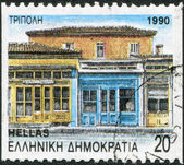 GREECE - CIRCA 1990: Postage stamps printed in Greece, shows Tripolis, street with neoclassical architecture, circa 1990 — Stock Photo