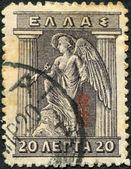 Grecia - circa 1916: muestra de sellos impresos en grecia, iris sosteniendo el caduceo, circa 1916 — Foto de Stock