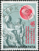 GREECE - CIRCA 1998: Postage stamps printed in Greece, dedicated to the 16th World Congress of Cardiology Research, shows Jason treats boys (an ancient bas-relief), circa 1998 — Stock Photo