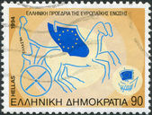 GREECE - CIRCA 1994: Postage stamps printed in Greece, dedicated to the Greek Presidency of European Community Council of Ministers, shows Winged chariot driven by Greece, circa 1994 — Stock Photo