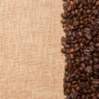 Coffee beans in row on canvas background — Stock Photo #11949575