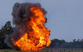 Explosion with flying debris — Stock Photo