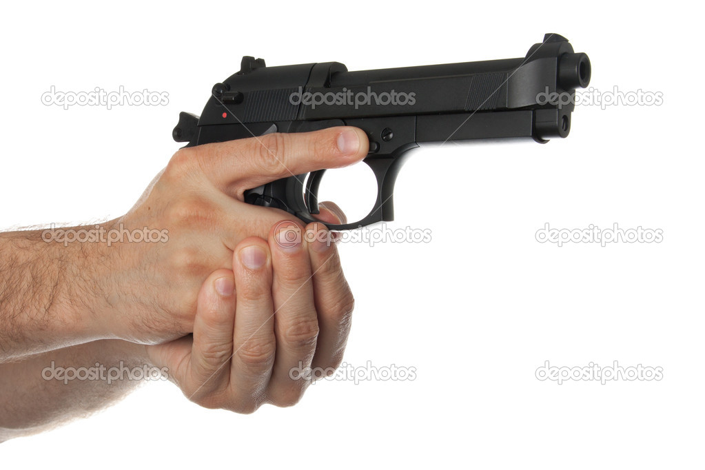 Two hands holding a gun with finger off the trigger ...