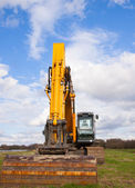 Used yellow excavator — Stock Photo