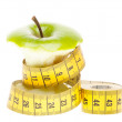 Dieting concept Green apple with measuring tape — Stock Photo #12016191