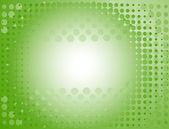 Gefleckte hintergrund in grün. vektor-illustration — Stockvektor