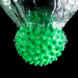 Stock Photo: Green ball with spikes.