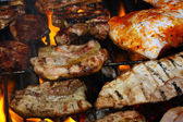 Steak meat on BBQ — Stock Photo