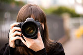 Woman taking a photo — Stock Photo