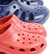 Colorful Plastic Clogs Isolated on White — Stock Photo