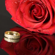 Royalty-Free Stock Photo: Red Rose and Wedding Ring