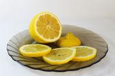 Lemon on a plate — Stock Photo