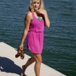 Pink dress dock hold shoes — Stock Photo