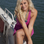 Pink dress sit side boat smile — Stock Photo