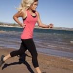 Woman run by in pink tank water — Stock Photo