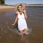 Woman white dress running in water — Stock Photo #11946342