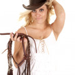 Cowgirl reins smiling — Stock Photo