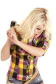 Woman with rubber mallet swinging — Stock Photo