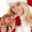 Mrs santa doughnut smirk — Stock Photo