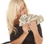 Woman black dress bite money — Stock Photo