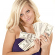 Woman purple handful of money — Stock Photo