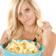 Woman with chips smiling — Stock Photo #11956250
