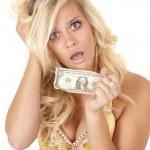 Woman worried last dollar — Stock Photo #11956553