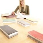 Woman happy big table study. — Stock Photo