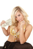 Woman greed genie hold money — Stock Photo