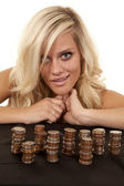 Woman leaning by coins — Stock Photo
