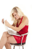 Woman red dress angry with computer — Stockfoto