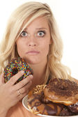 Woman shocked donut — Stock Photo
